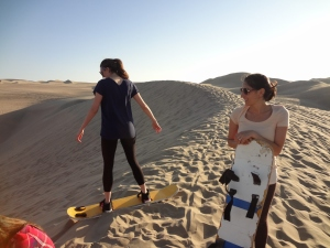 Caitlin (l) and Alisa (r) sand boarding in Huacachina